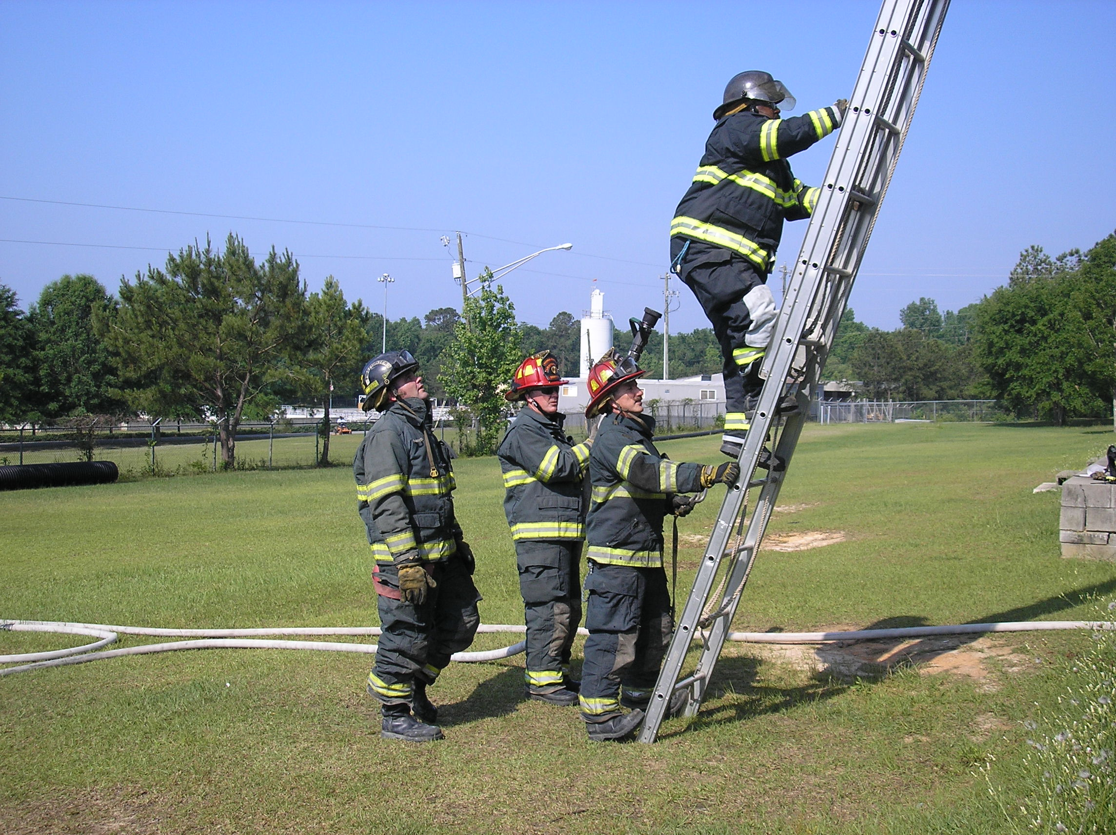 Fire Fighters on a Ladder